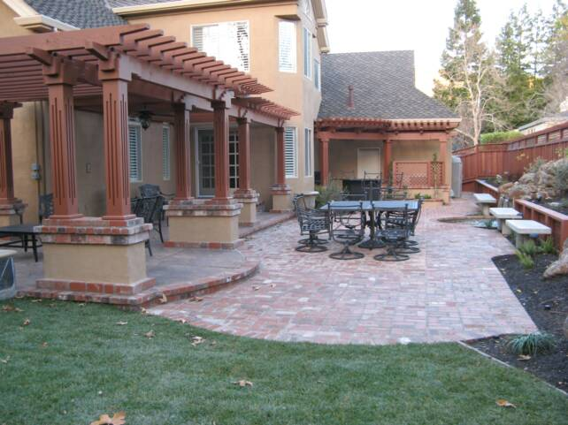 ... STAMPED CONCRETE PATIO WITH BRICK BORDER